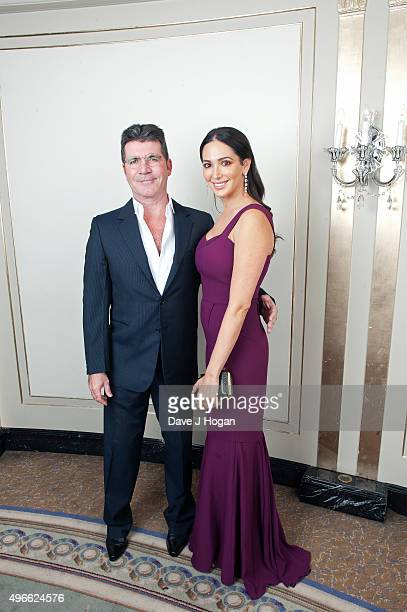 Simon Cowell and Lauren Silverman attend the Shooting Star Chase Ball at The Dorchester on October 4 2014 in London England