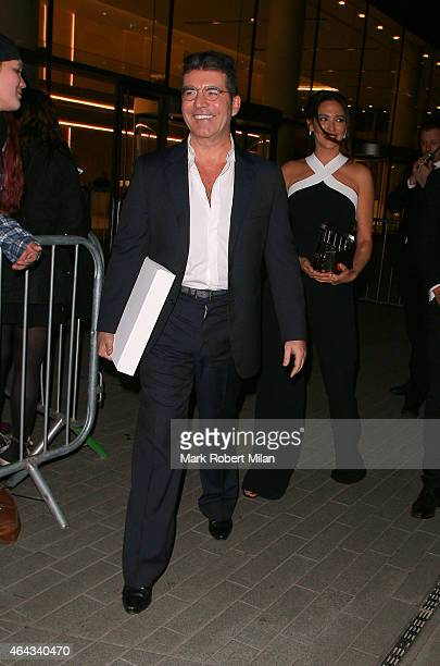 Simon Cowell and Lauren Silverman attending the Elle Style Awards on February 24 2015 in London England