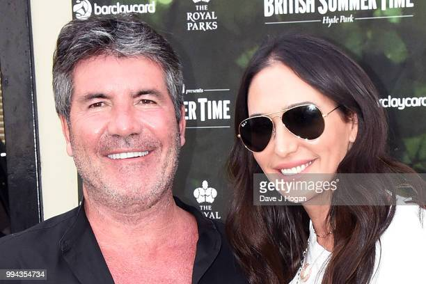 Simon Cowell and Lauren Silverman pose backstage as Barclaycard present British Summer Time Hyde Park at Hyde Park on July 6 2018 in London England