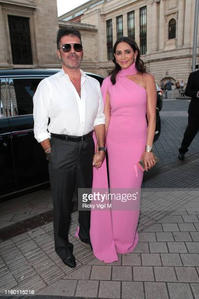 Simon Cowell and Lauren Silverman seen attending Syco summer party at Victoria and Albert Museum on July 04 2019 in London England