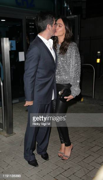 """Simon Cowell and Lauren Silverman seen leaving LH2 studios after """"The X Factor: Celebrity"""" on November 30, 2019 in London, England."""