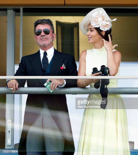 Simon Cowell and Lauren Silverman watch the racing as they attend day 1 of Royal Ascot at Ascot Racecourse on June 15, 2021 in Ascot, England.