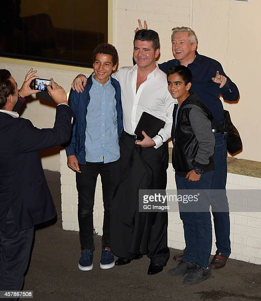 Simon Cowell and Louis Walsh leave the X Factor studio on October 25 2014 in London England