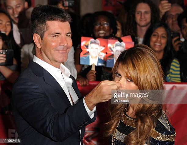 Simon Cowell and Paula Abdul attend The X Factor World Premiere Screening at ArcLight Cinemas on September 14 2011 in Hollywood California