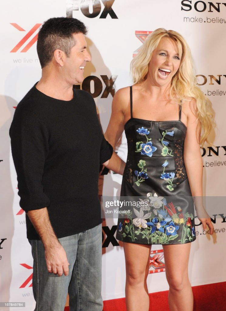 Simon Cowell and recording artist Britney Spears arrive at The X-Factor Viewing Party at on December 6, 2012 in Los Angeles, California.