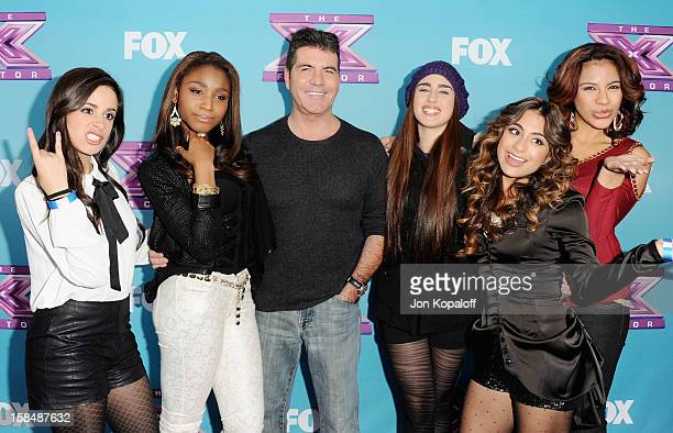 Simon Cowell and the Lylas pose at The X Factor' Season Finale Press Conference at CBS Studios on December 17 2012 in Los Angeles California