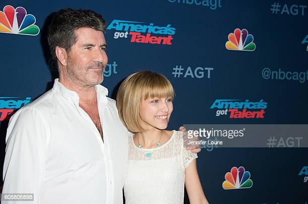 Simon Cowell and winner of 'America's Got Talent' Season 11 Grace Vanderwaal arrive at the 'America's Got Talent' Season 11 Finale Live Show at the...