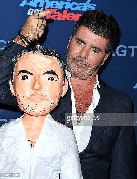 Simon Cowell arrives at the America's Got Talent Season 11 Finale Live Show at Dolby Theatre on September 13 2016 in Hollywood California