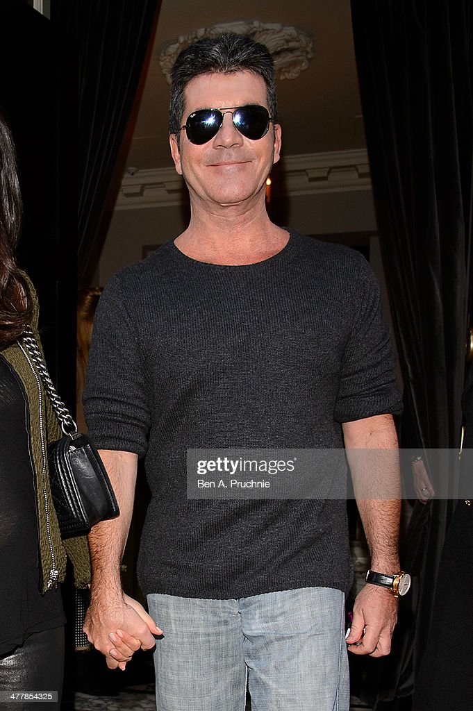 Simon Cowell attends as Cheryl Cole announces her return to the X Factor judging panel on March 11, 2014 in London, England.