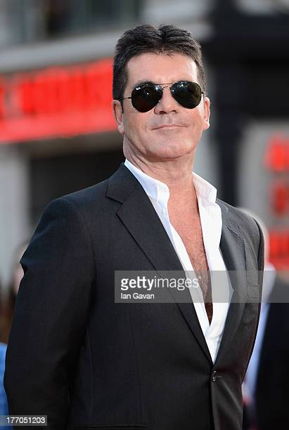 Simon Cowell attends the One Direction This Is Us world premiere at the Empire Leicester Square on August 20 2013 in London England