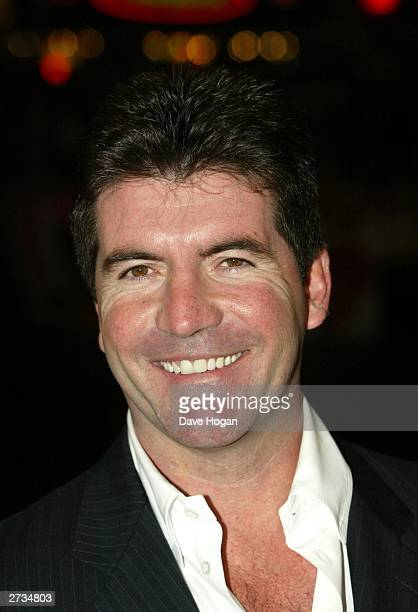 "Simon Cowell attends the UK charity film premiere of ""Love Actually"" at The Odeon Leicester Square on November 16, 2003 in London."