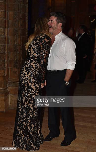 Simon Cowell greets Leona Lewis as they attends a reception and dinner for supporters of The British Asian Trust at Natural History Museum on...