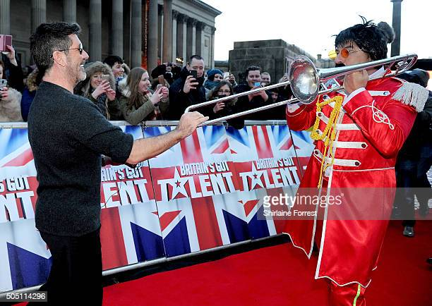 Simon Cowell is joined on the red carpet by David Walliams dressed as Sgt Pepper accompanied by a brass band playing The Beatles 'When I'm 64' while...