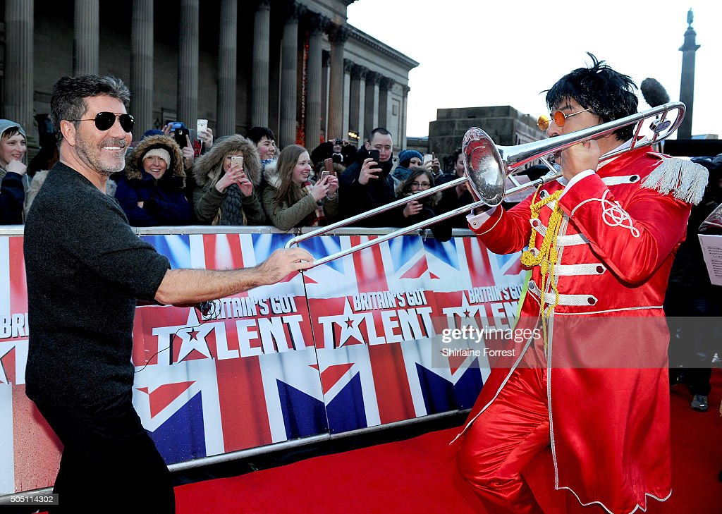 Simon Cowell is joined on the red carpet by David Walliams dressed as Sgt Pepper accompanied by a brass band playing The Beatles 'When I'm 64' while attending the Liverpool auditions for Britain's Got Talent at Liverpool Empire Theatre on January 15, 2016 in Liverpool, England.