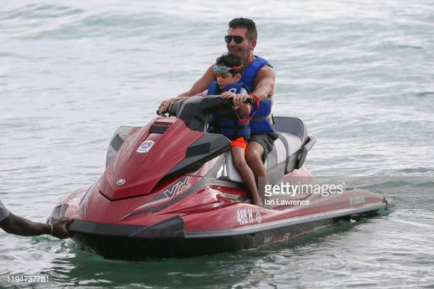 Simon Cowell is seen jet skiing with his son Eric on December 18, 2019 in Bridgetown, Barbados.