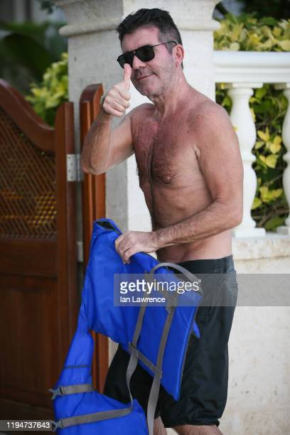 Simon Cowell is seen on the beach on December 18 2019 in Bridgetown Barbados