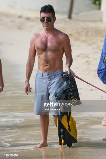 Simon Cowell is seen on the beach on December 22 2019 in Bridgetown Barbados