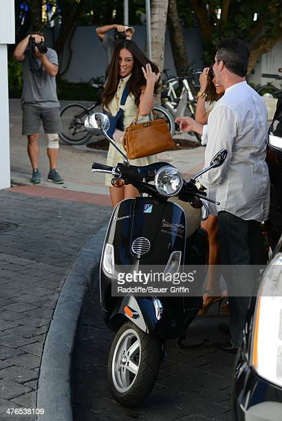 Simon Cowell is seen parking his Vespa scooter while meeting Terri Seymour for lunch on March 03 2014 in Miami Florida