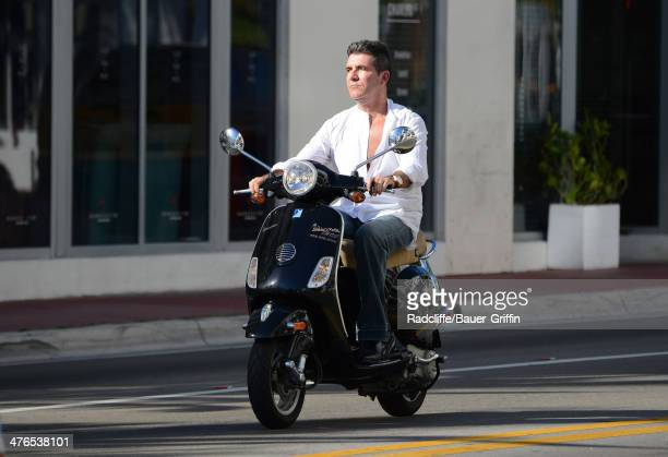 Simon Cowell is seen riding a Vespa scooter on March 03 2014 in Miami Florida