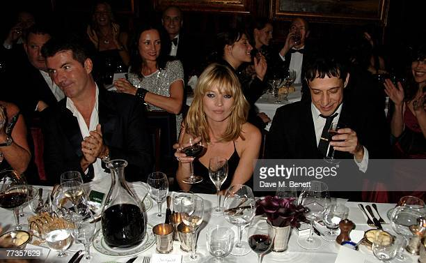 Simon Cowell Kate Moss and Jamie Hince attend the launch of Kate Moss's new Top Shop 'Christmas Range' collection at Annabel's October 16 2007 in...