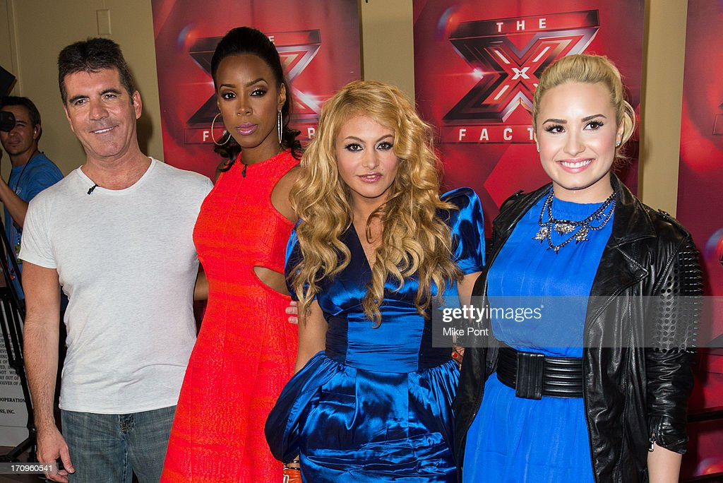 Simon Cowell, Kelly Rowland, Paulina Rubio, and Demi Lovato attend 'The X Factor' Judges press conference at Nassau Veterans Memorial Coliseum on June 20, 2013 in Uniondale, New York.