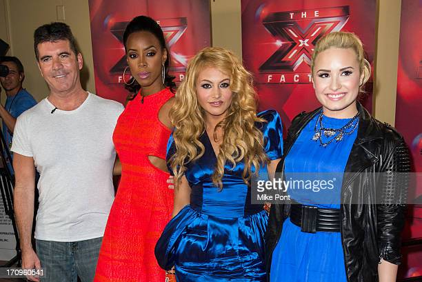 """Simon Cowell, Kelly Rowland, Paulina Rubio, and Demi Lovato attend """"The X Factor"""" Judges press conference at Nassau Veterans Memorial Coliseum on..."""