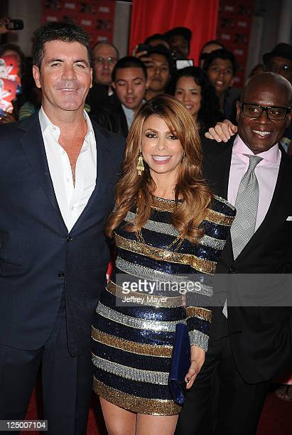 Simon Cowell Paula Abdul and Antonio LA Reid attend The X Factor World Premiere Screening at ArcLight Cinemas on September 14 2011 in Hollywood...