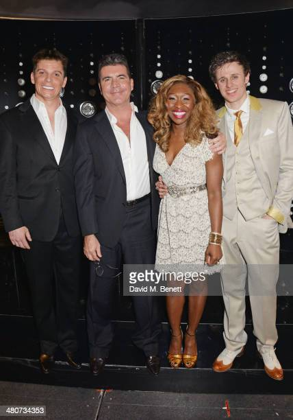 Simon Cowell poses with cast members Nigel Harman Cynthia Erivo and Alan Morrissey backstage at the press night performance of I Can't Sing The X...
