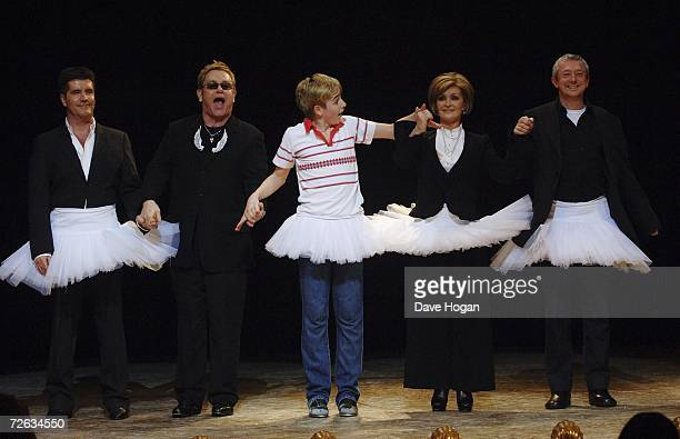 Simon Cowell, Sir Elton John, Liam Mower, Sharon Osbourne and Louis Walsh appear on stage for the curtain call of the charity gala performance of...
