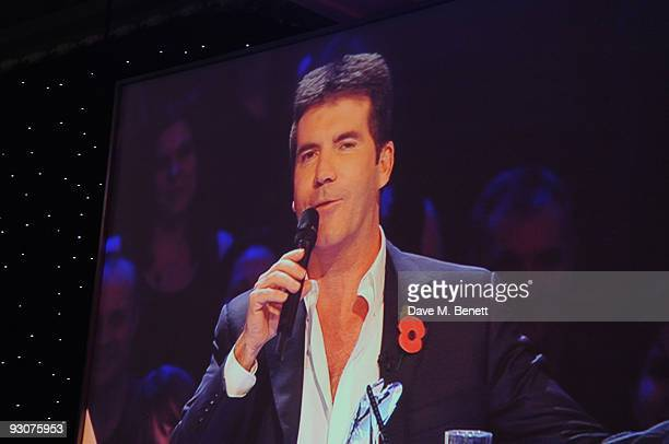 Simon Cowell via video link receives The Daily Mirror Best British TV Judge Award during the Variety Club Showbiz Awards at the Grosvenor House on...