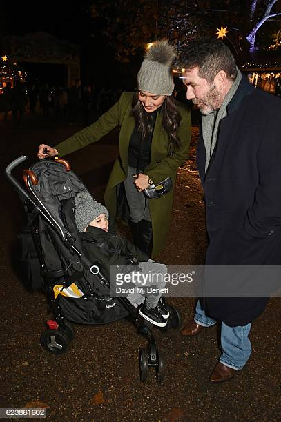 Simon Cowell with Lauren Silverman and son Eric Cowell attend a VIP Preview of Hyde Park's Winter Wonderland 2016 on November 17 2016 in London...