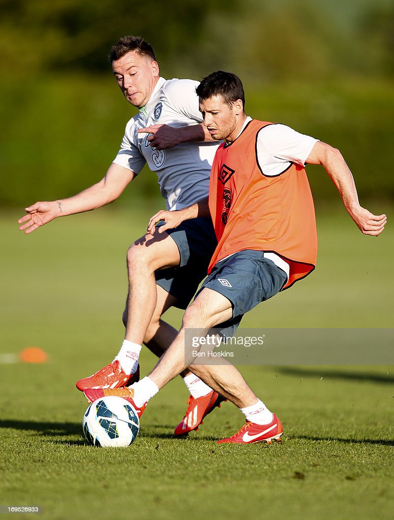 Simon Cox and Marc Wilson (R) of the Republic of Ireland compete for the ball during an Ireland training session at Watford FC Training Ground on May 26, 2013 near St Albans, London Colney, England.