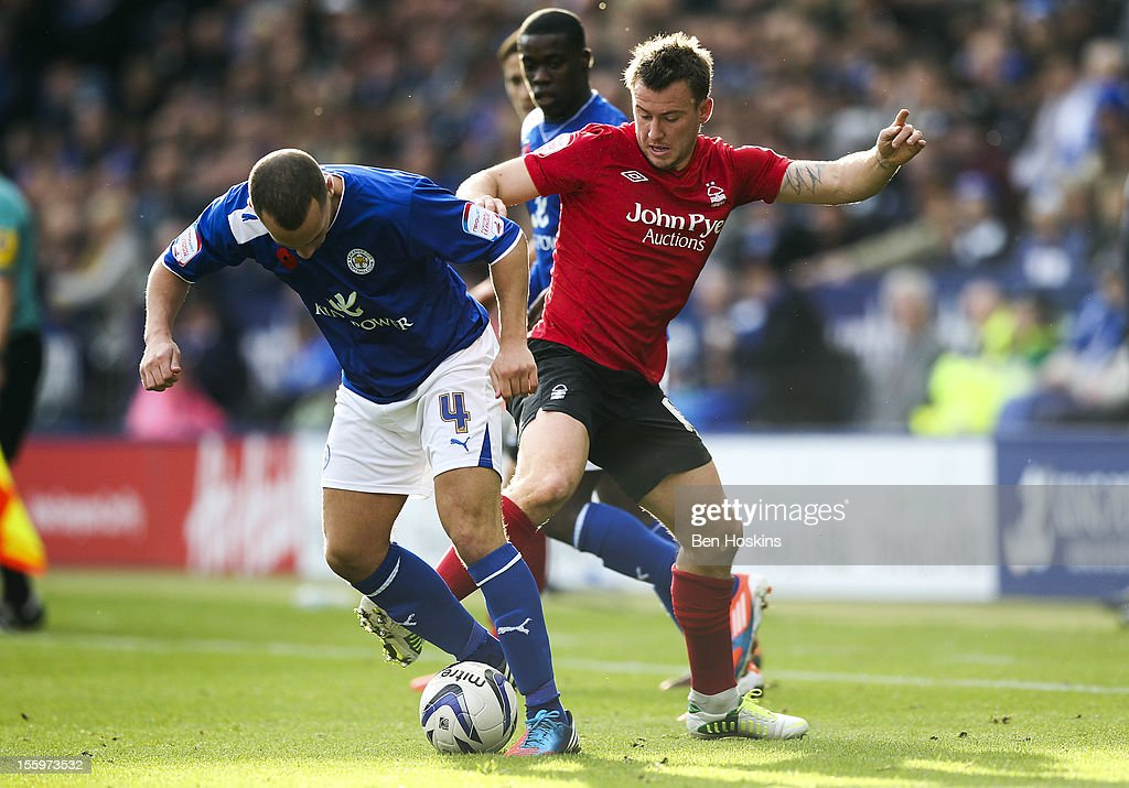 Simon Cox of Nottingham battles with Danny Drinkwater of Leicester during the npower Championship match between Leicester City and Nottingham Forest at the King Power Stadium on November 10, 2012 in Leicester, England.