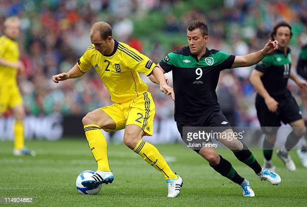 Simon Cox of Republic of Ireland battles with Steven Whittaker of Scotland during the Carling Nations Cup match between Republic of Ireland and...