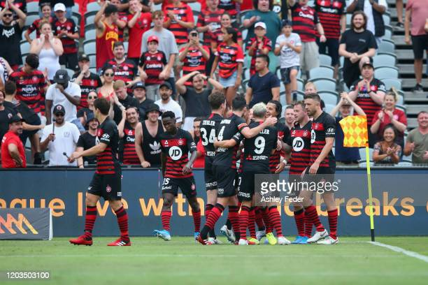Simon Cox of Western Sydney Wanderers celebrates his goal with team mates during the round 17 A-League match between the Central Mariners and the...