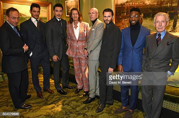 Simon Cundey David Gandy Hu Bing Pierre Lagrange Dylan Jones Carlo Brandelli Tinie Tempah and Edward Sexton attend a cocktail reception hosted by the...