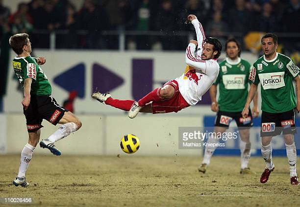 Simon Cziommer of Salzburg jumps for a shot during the tipp3Bundesliga powered by TMobile match between SV Josko Ried and FC Red Bull Salzburg at...