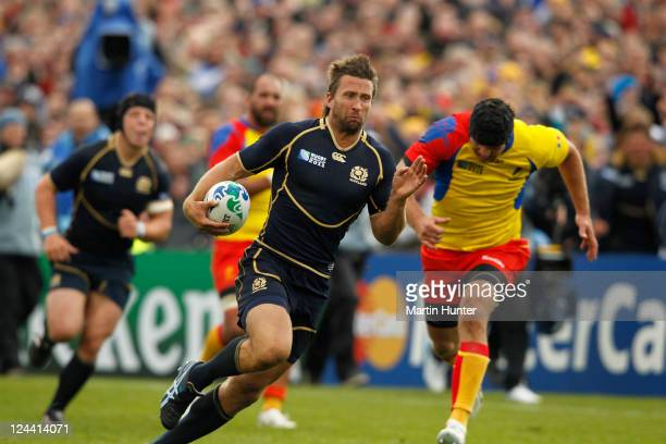 Simon Danielli of Scotland breaks through the Romanian defence to score a try during the IRB 2011 Rugby World Cup Pool B match between Scotland and...