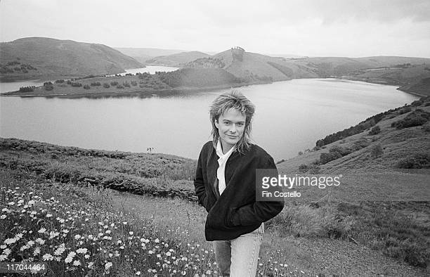 Simon Darlow, British musician, songwriter and composer-arranger, poses for a portrait while standing overlooking the River Dyfi in Dylife, Powys,...