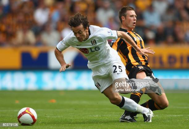 Simon Davies of Fulham battles with Nick Barnby of Hull during the Barclays Premier League match between Hull Ciy and Fulham at the KC Stadium on...