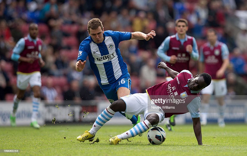 Simon Dawkins of Aston Villa is challenged by James McArthur of Wigan Athletic during the Barclays Premier League match between Wigan Athletic and Aston Villa at DW Stadium on May 19, 2013 in Wigan, England.