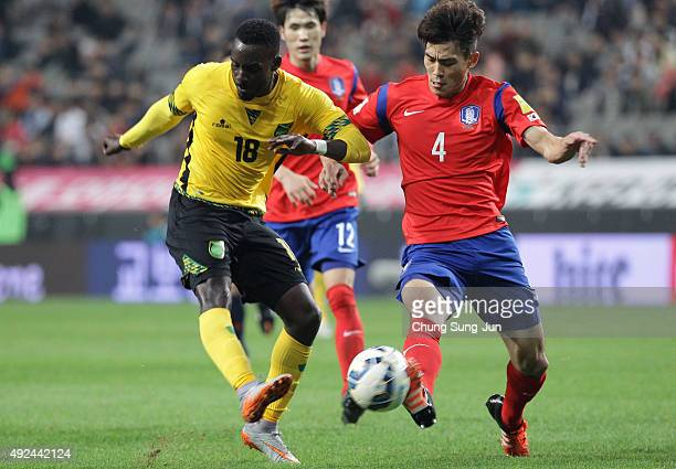 Simon Dawkins of Jamaica competes for the ball with Kim KeeHee of South Korea during the international friendly match between South Korea and Jamaica...