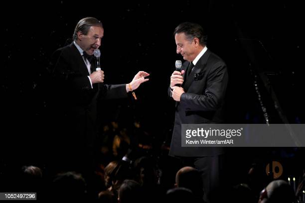 Simon de Pury and Andy Garcia speak onstage at the amfAR Gala Los Angeles 2018 at Wallis Annenberg Center for the Performing Arts on October 18 2018...