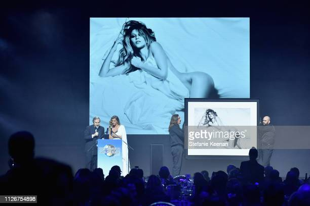 Simon de Pury and Gisele Bündchen speak onstage at the UCLA IoES honors Barbra Streisand and Gisele Bundchen at the 2019 Hollywood for Science Gala...