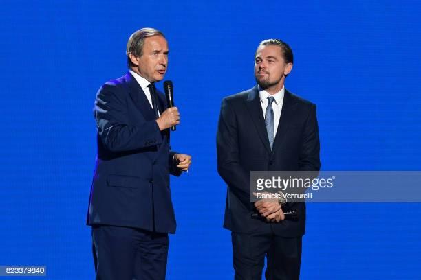 Simon de Pury and Leonardo DiCaprio are seen on stage during the Leonardo DiCaprio Foundation 4th Annual SaintTropez Gala at Domaine Bertaud Belieu...