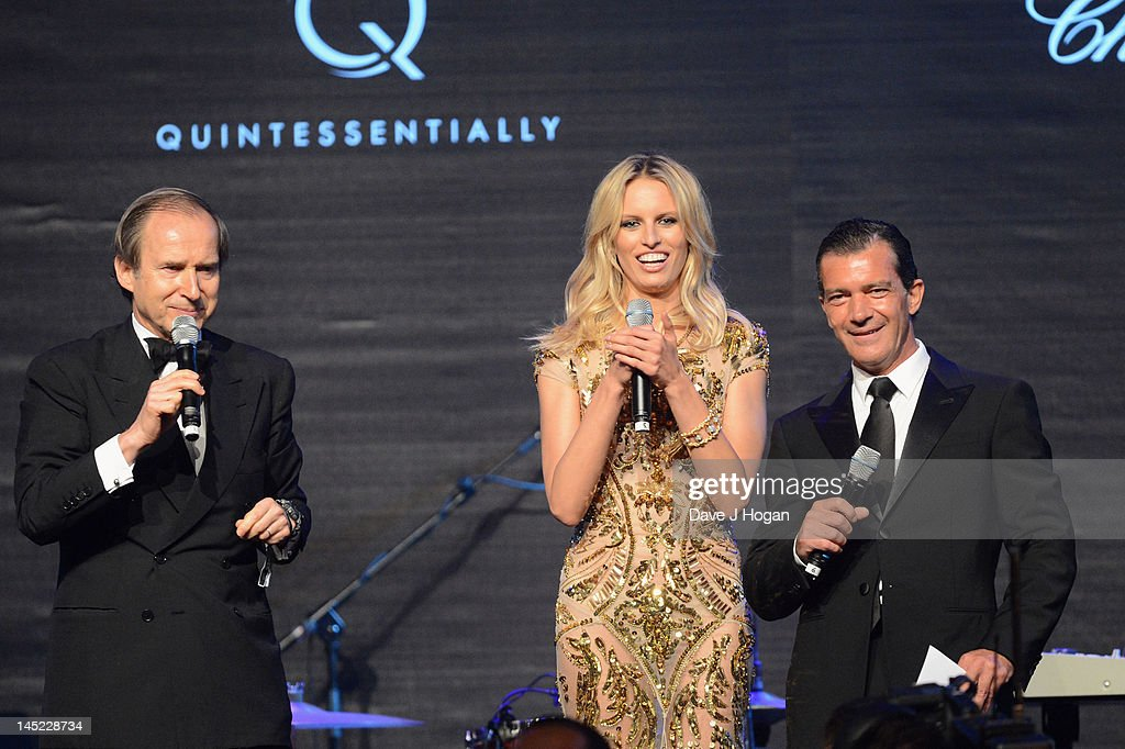 Simon de Pury, model Karolina Kurkova and actor Antonio Banderas speak onstage during the 2012 amfAR's Cinema Against AIDS during the 65th Annual Cannes Film Festival at Hotel Du Cap on May 24, 2012 in Cap D'Antibes, France.