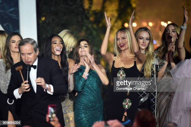 Simon De Pury Winnie Harlow Carine Roitfeld Natasha Poly and model on stage at the amfAR Gala Cannes 2018 at Hotel du CapEdenRoc on May 17 2018 in...