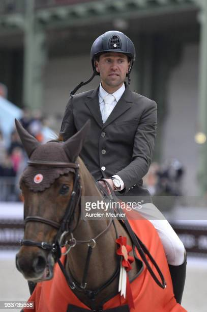 Simon Delestre of France on Hermes Ryan cheers with the crowd after winning the Saut Hermes at Le Grand Palais on March 18 2018 in Paris France