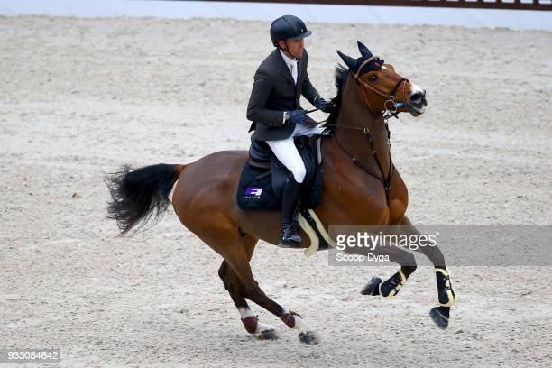 Simon DELESTRE riding Sultan de Beaufour competes in the Saut Hermes CSI5* of Le Saut Hermes 2018 at Grand Palais on March 17 2018 in Paris France