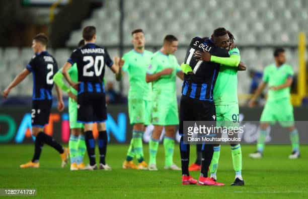 Simon Deli of Club Brugge and Jean-Daniel Akpa Akpro of S.S. Lazio embrace following the UEFA Champions League Group F stage match between Club...